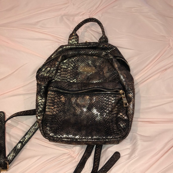 BCBG Paris Handbags - Bcbg gold & black mini backpack!